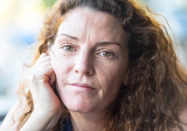 Pensive Mature woman looking at the camera wearing no make up